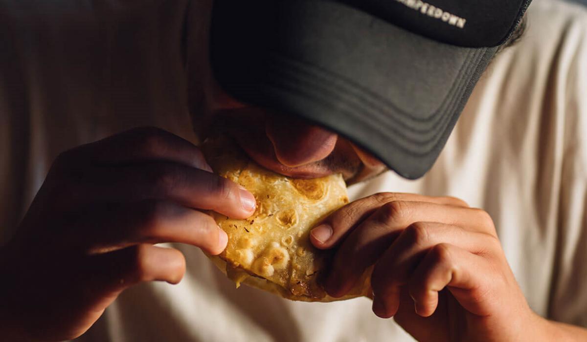 Kitch não é uma app de entregas, mas promete que irá receber a comida do seu restaurante preferido de pantufas